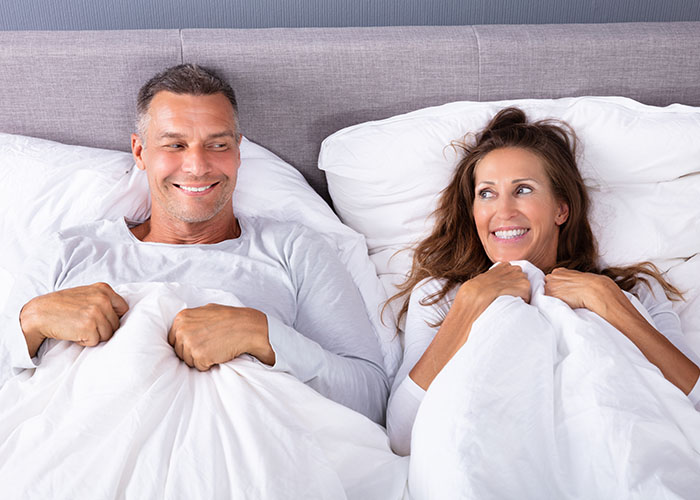Middle Aged Couple In Bed | Resurgence Wellness